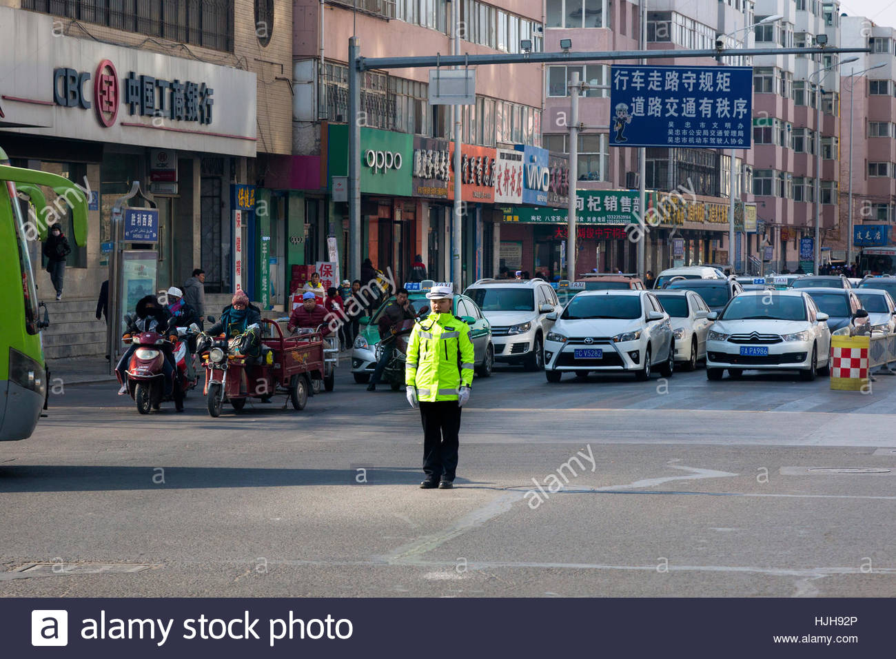 Police control at traffic junction, Wuzhong, Ningxia, China - Stock Image