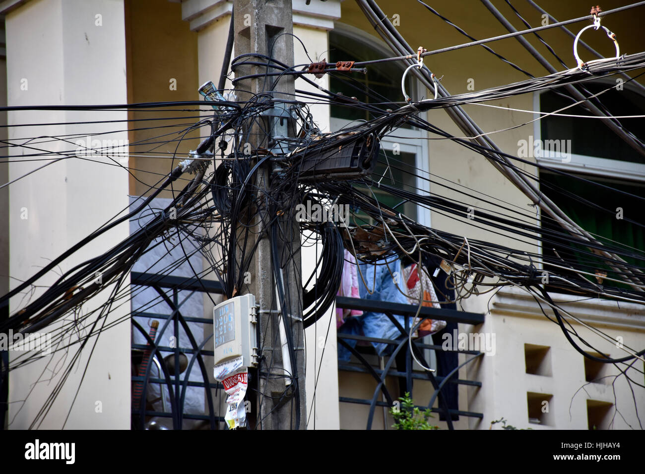 Entangled electrical wires on the streets of Ho Chi Minh City, Vietnam - Stock Image