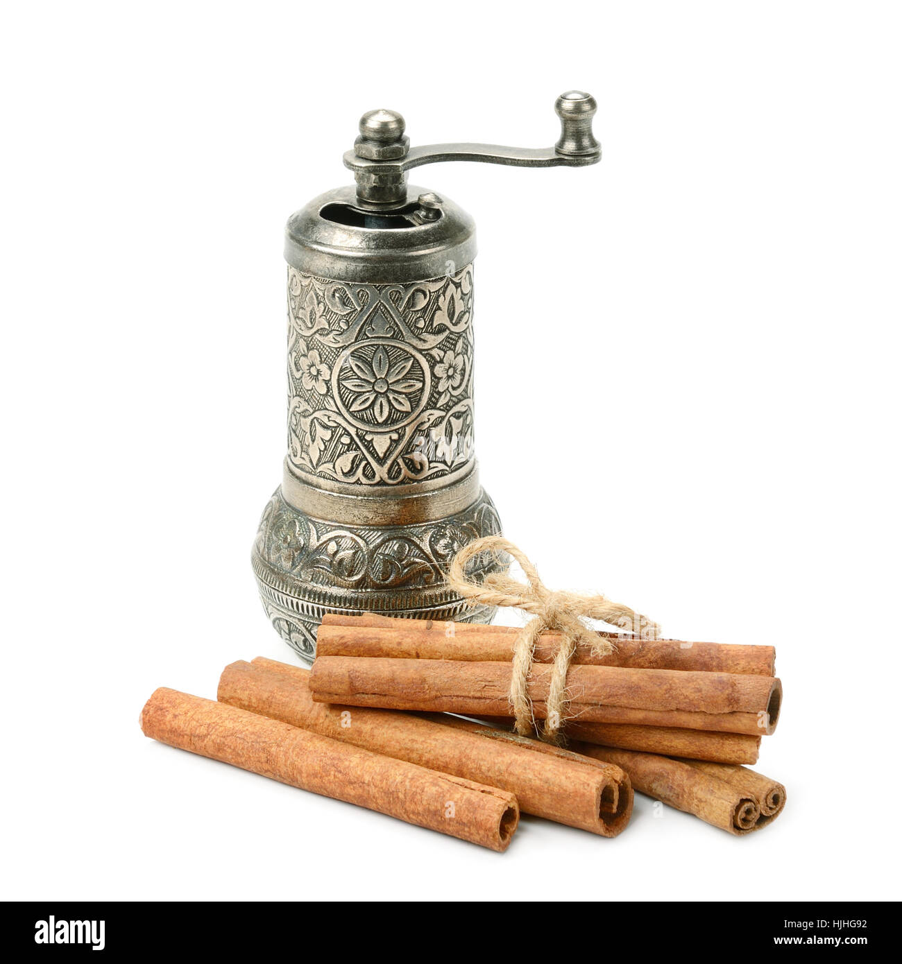 cinnamon and manual coffee grinder isolated on white background - Stock Image