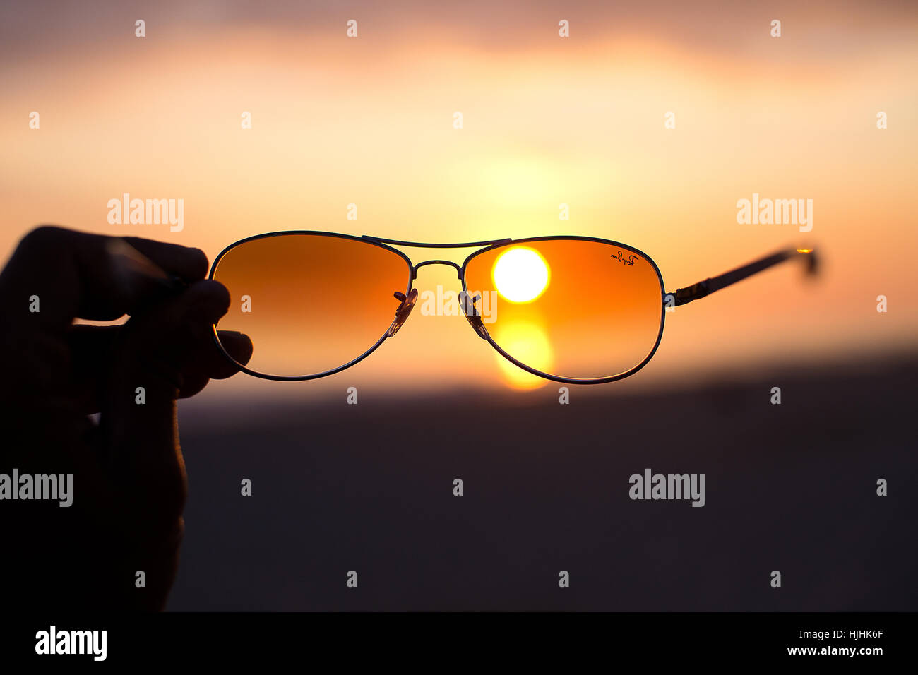 sunglasses and sunset - Stock Image