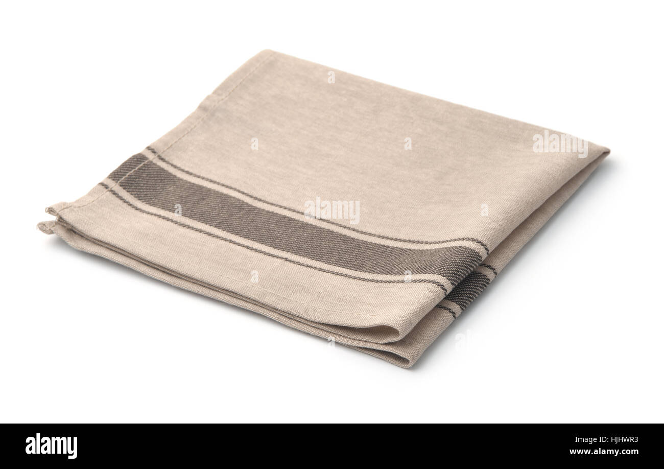 Single beige linen napkin isolated on white - Stock Image
