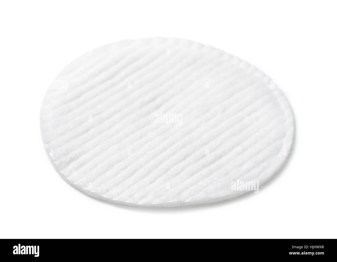 Single cosmetics cotton pad isolated on white - Stock Image