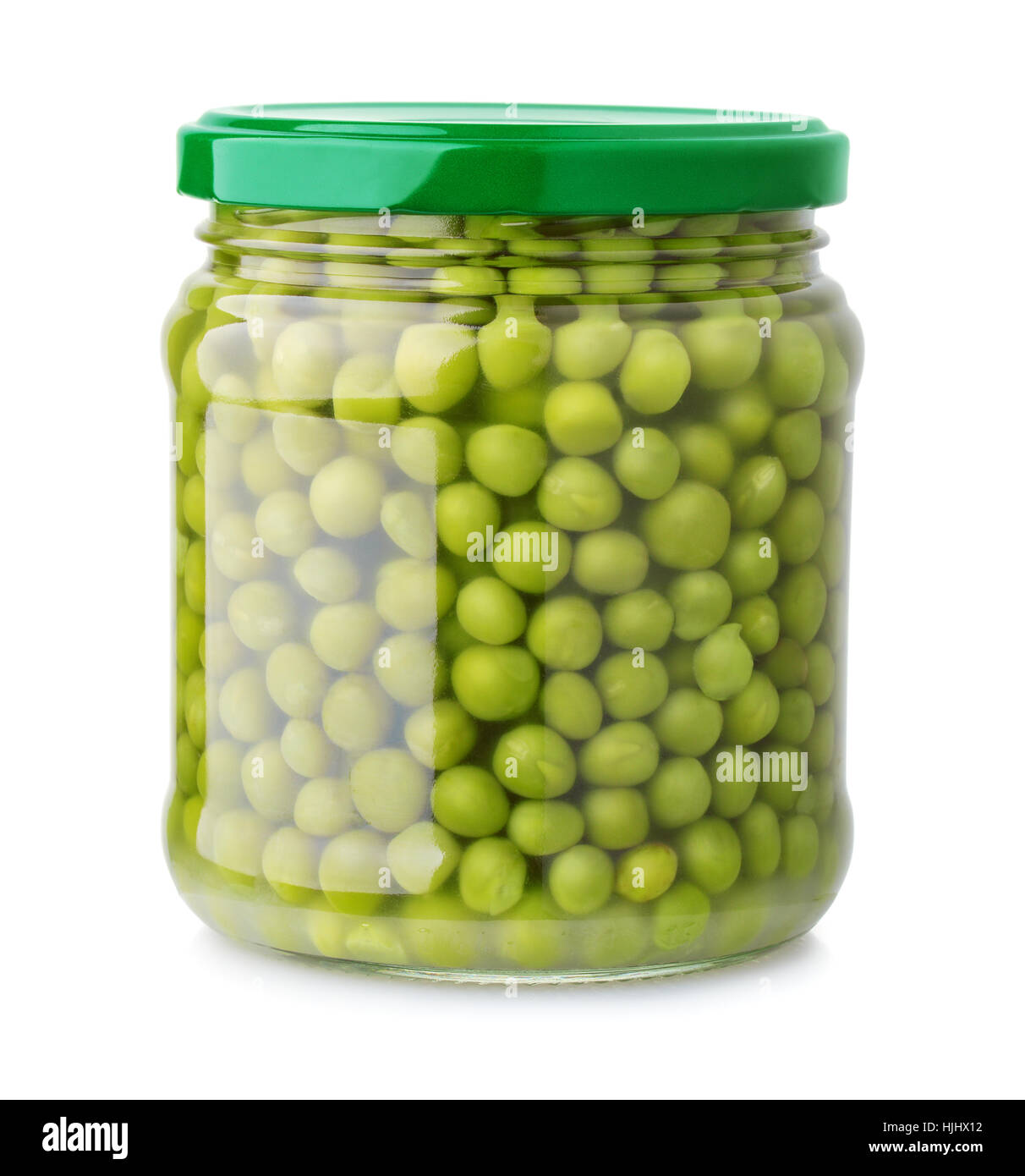 Glass jar of green peas isolated on white - Stock Image