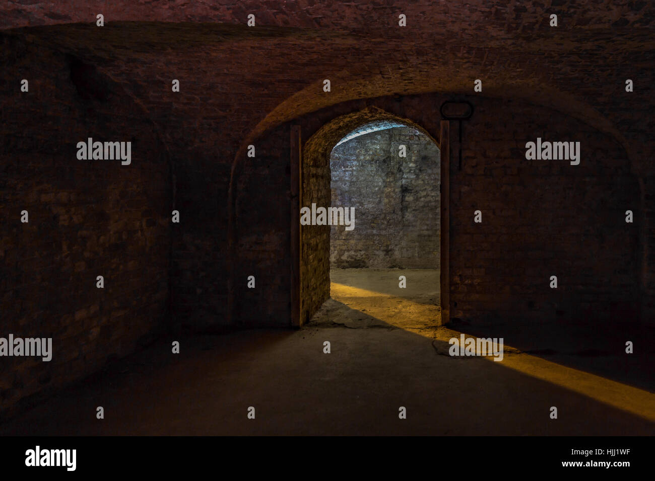 Cellar Room, shot shows a dark cellar with a beam of light at the entrance and giving a shadowy view of the cellar. - Stock Image