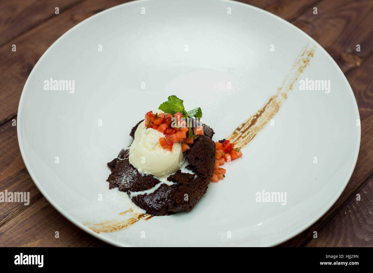 dessert, chocolate fondant with ice cream on a white plate Stock Photo