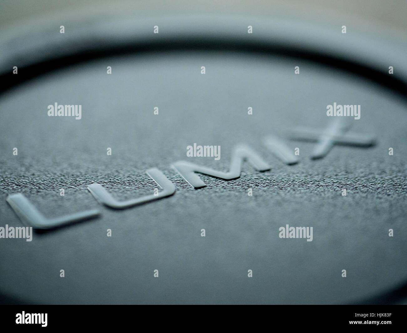 The word Lumix from a Panasonic Lumix lens cap - Stock Image
