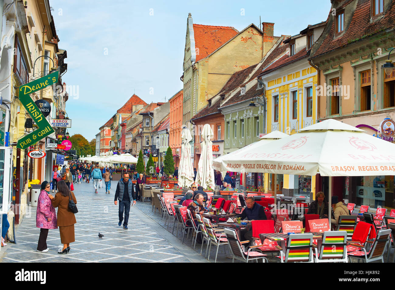 People on Old Town street of Brasov. Brasov is a city in Romania and the administrative centre of Brasov County. - Stock Image