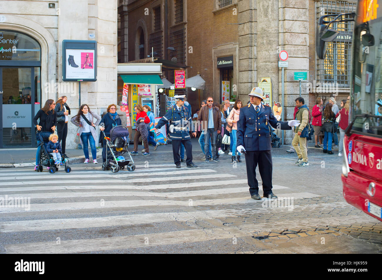 Road policeman regulate traffic in Old Town of Rome. Italy. - Stock Image