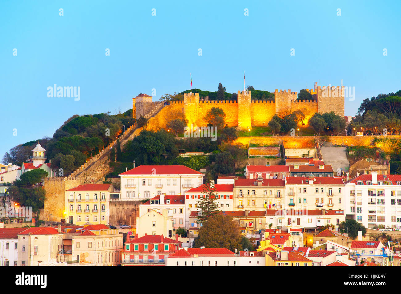 Lisbon Castle on a top of a hill at twilight. Lisbon, Portugal Stock Photo