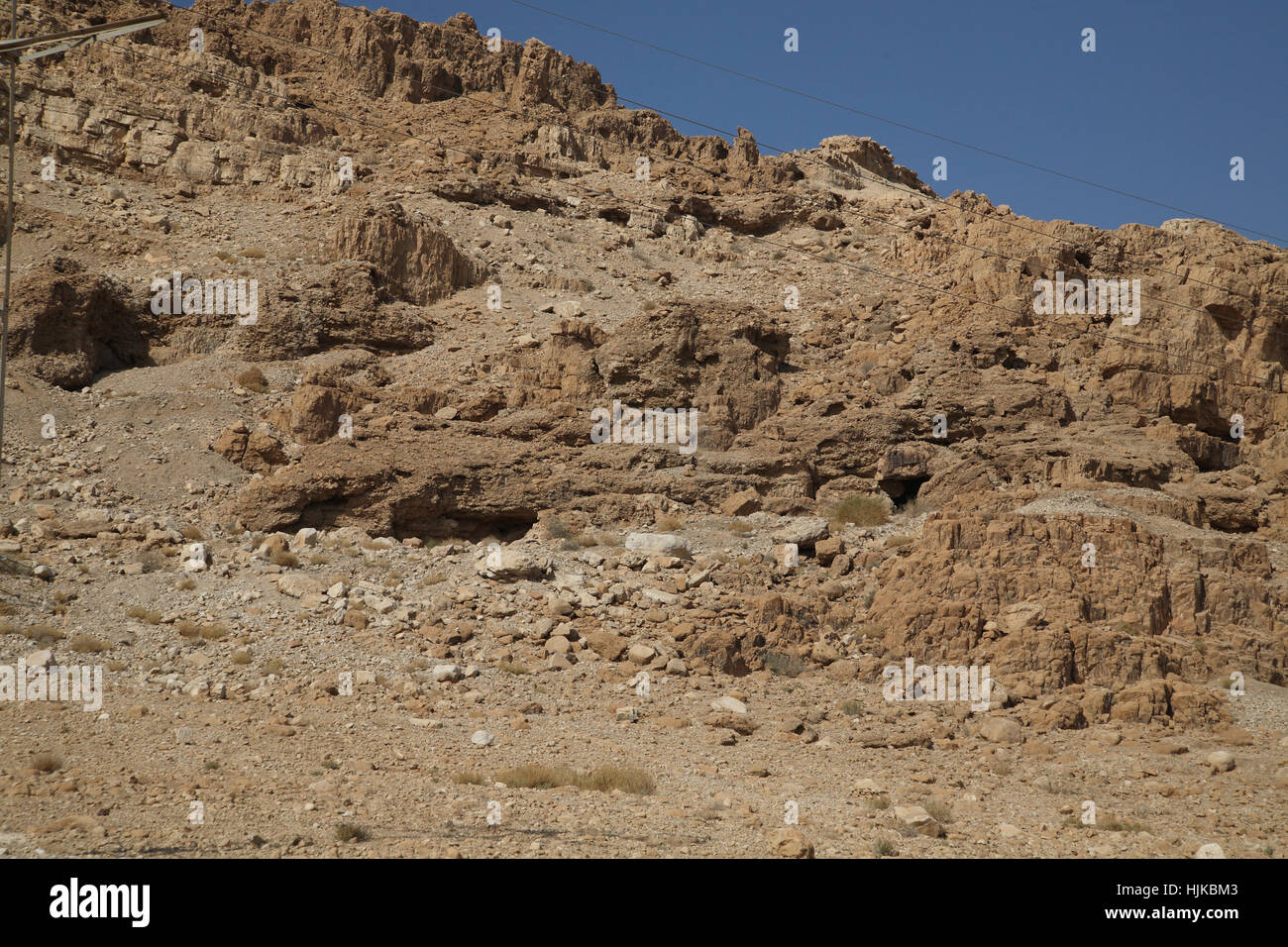 Qumran by the Dead Sea, a hole right of center which is cave 11 where the Temple Scroll and parts of 24 other scrolls Stock Photo
