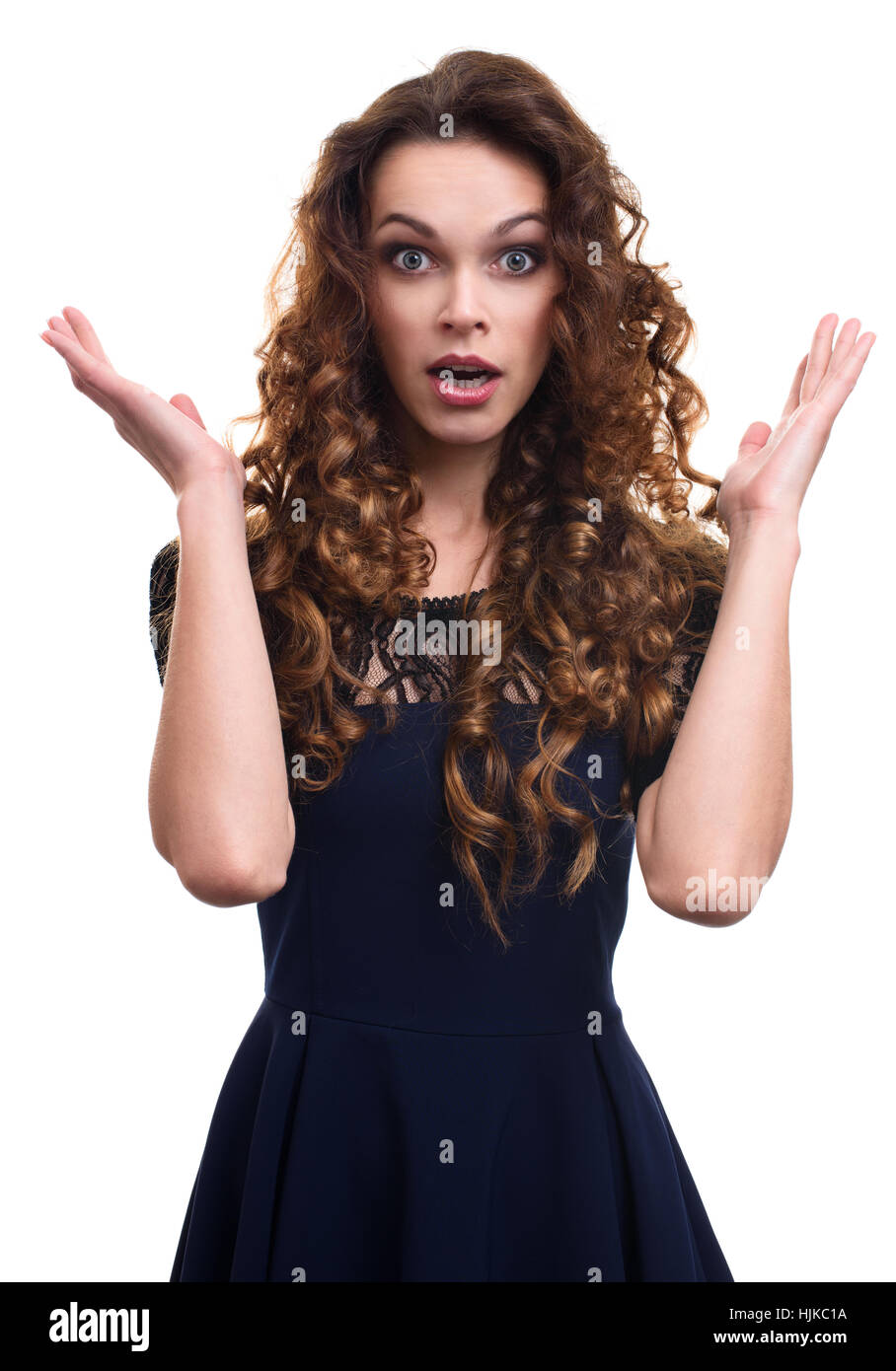 bbf64c313e7 Surprised happy beautiful woman with curly hair isolated on white background  - Stock Image