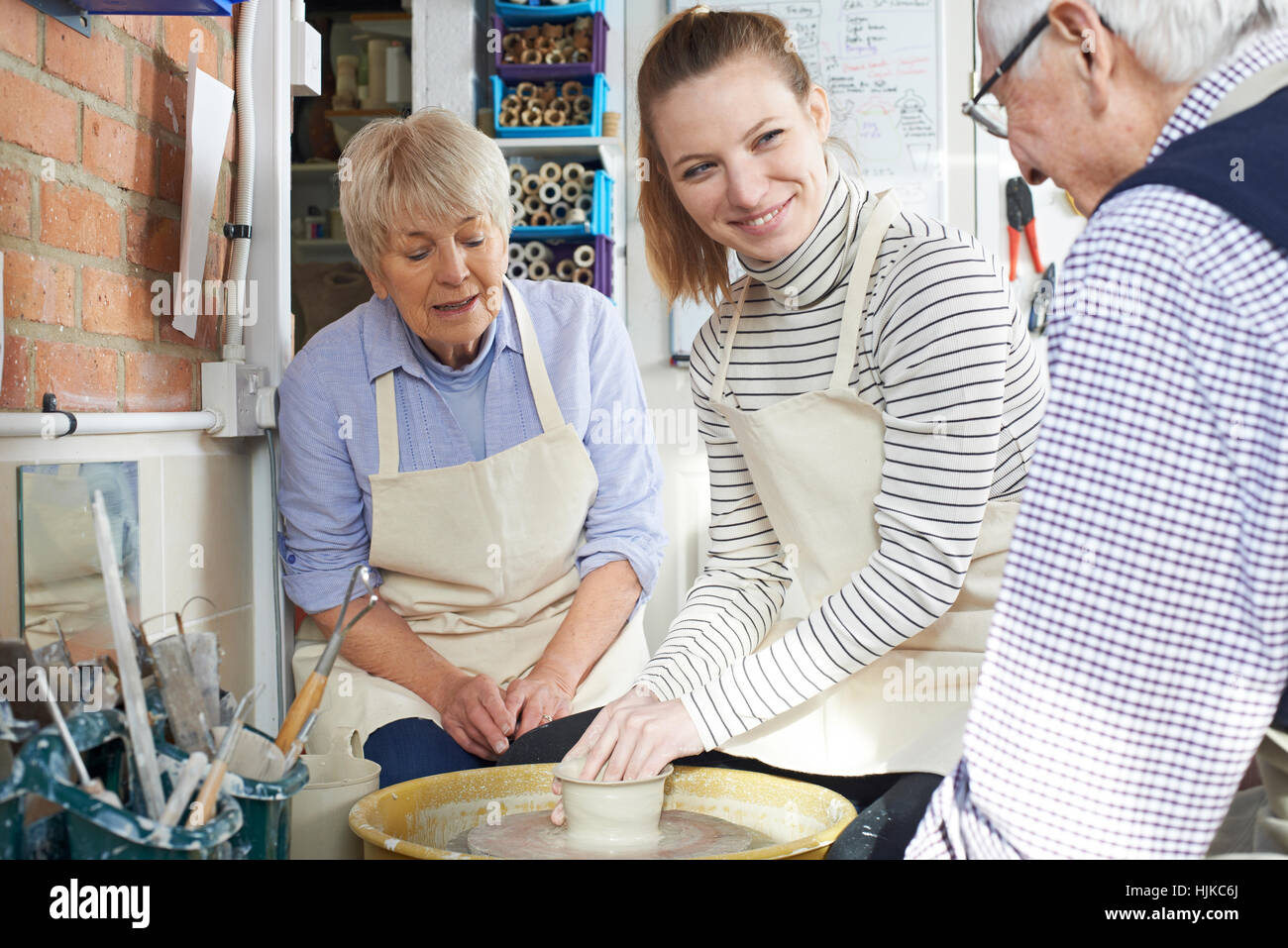 Seniors With Teacher In Pottery Class - Stock Image