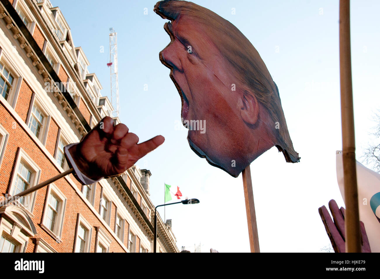 Women's anti-Trump march, London.Trump's head on a stick, and one of his hands - Stock Image