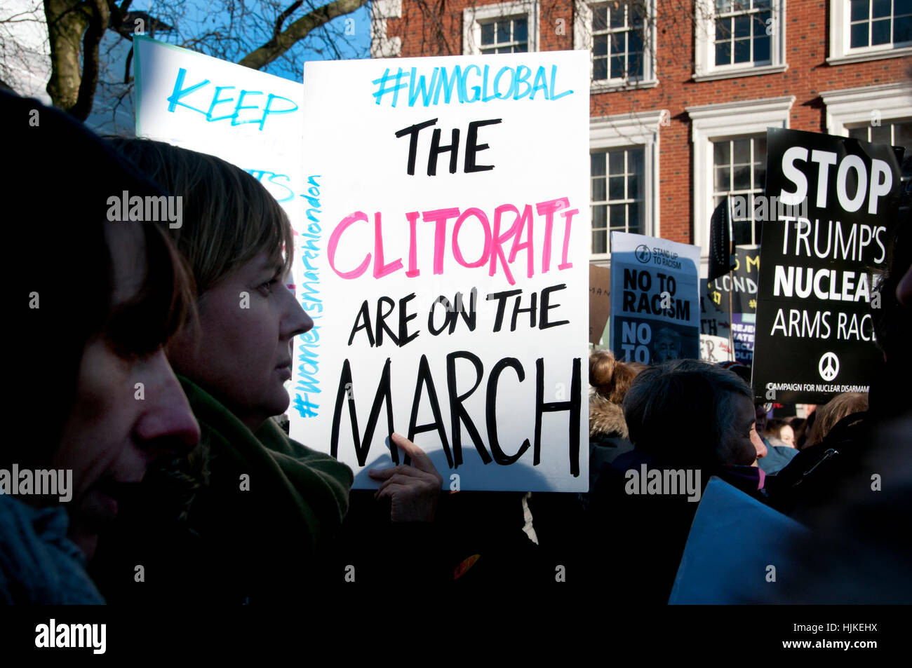 Women's anti-Trump march, London.Placard saying 'The clitorati are on the move'. - Stock Image