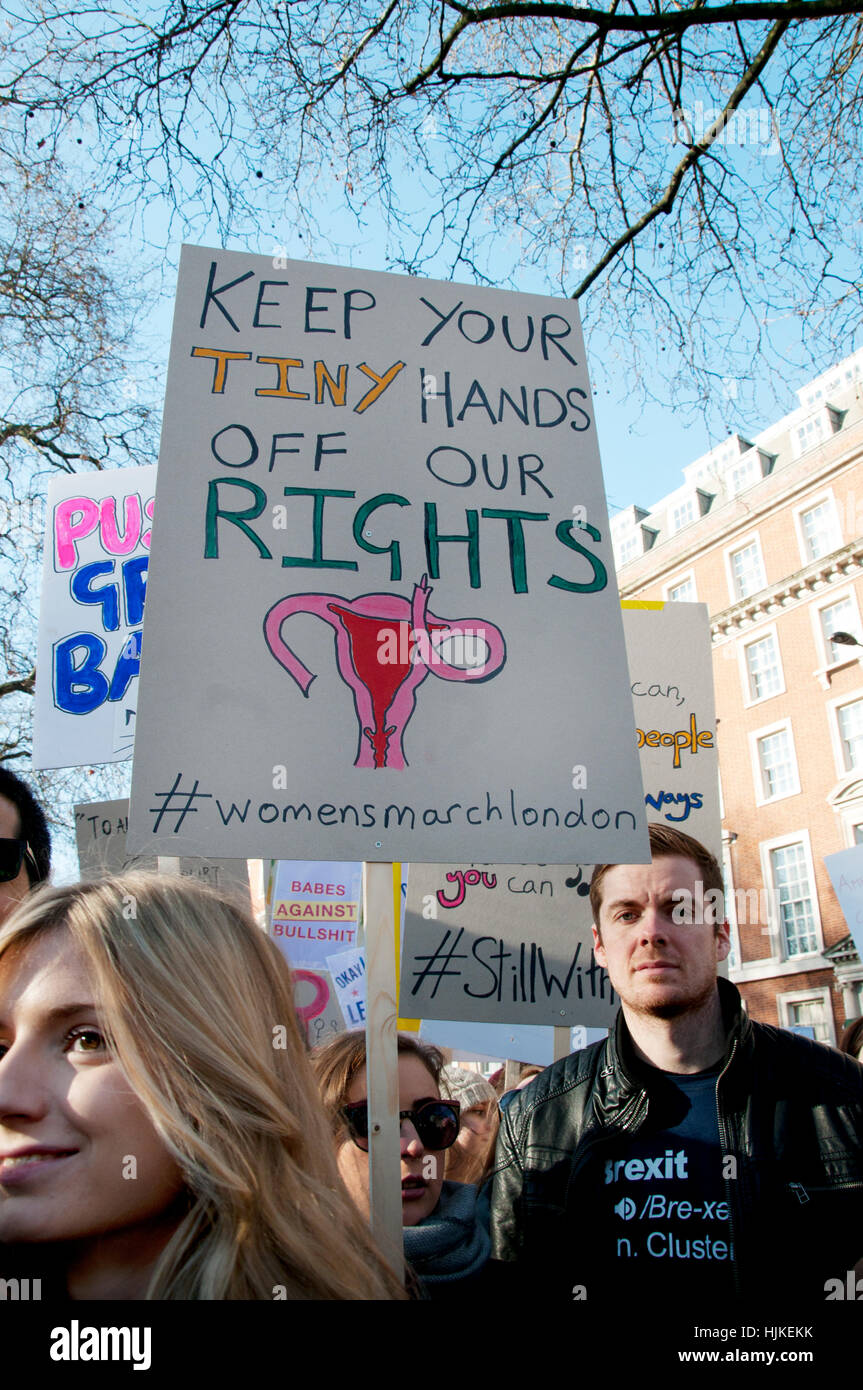 Women's anti-Trump march, London.Placard saying 'Keep your tiny hands off our rights'. - Stock Image