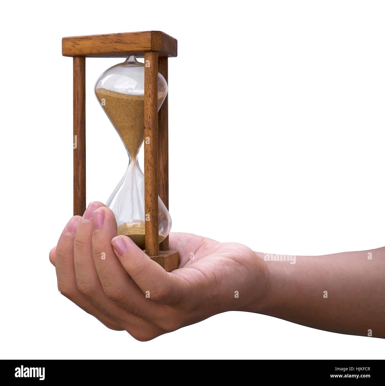 Hourglass on hand - Stock Image