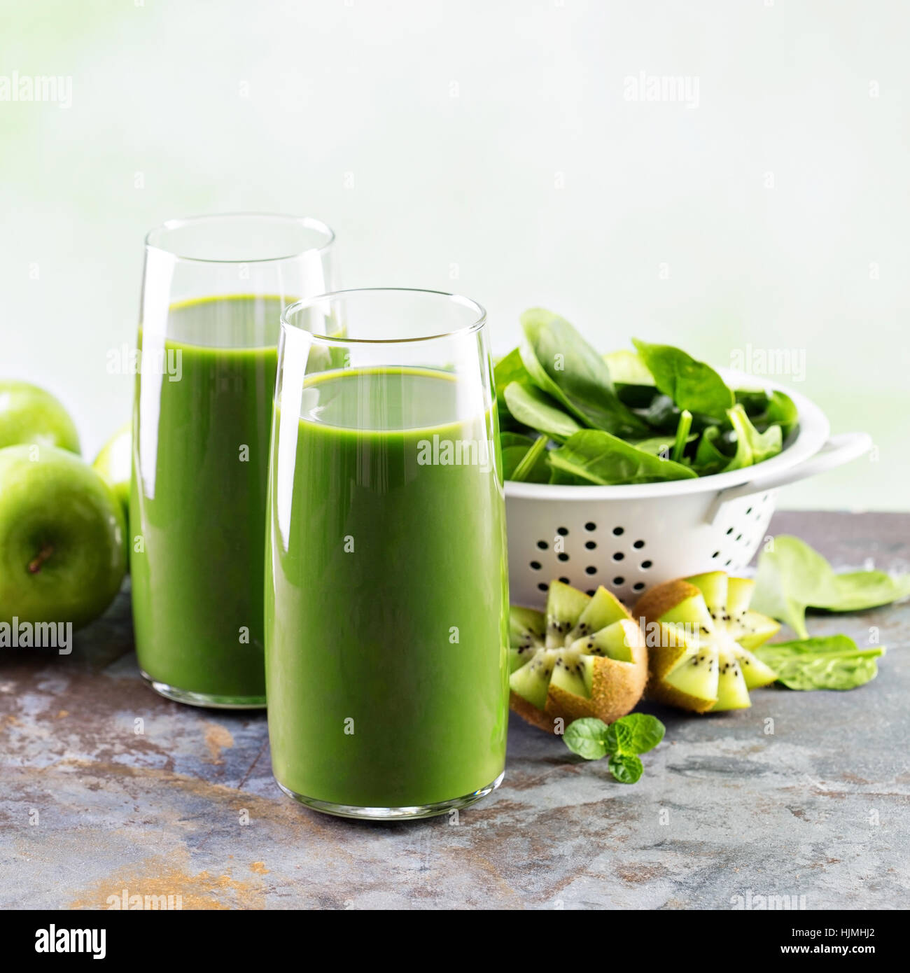 Green juice in tall glasses Stock Photo