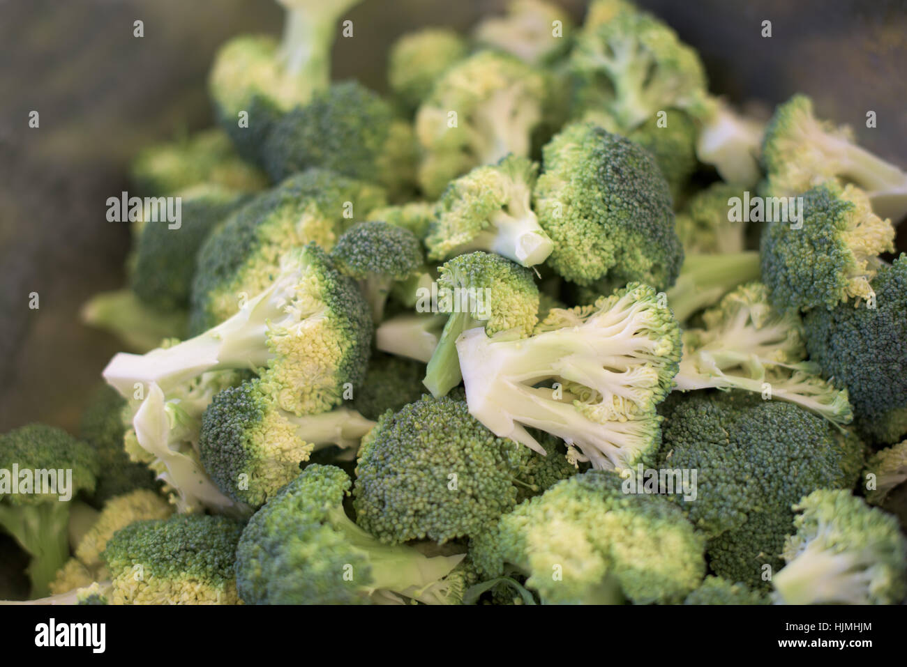 Broccoli pieces, ready for cooking - Stock Image
