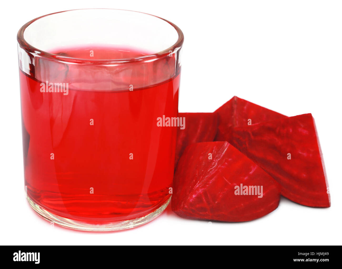 Fresh Beet with juice in glass over white background Stock Photo
