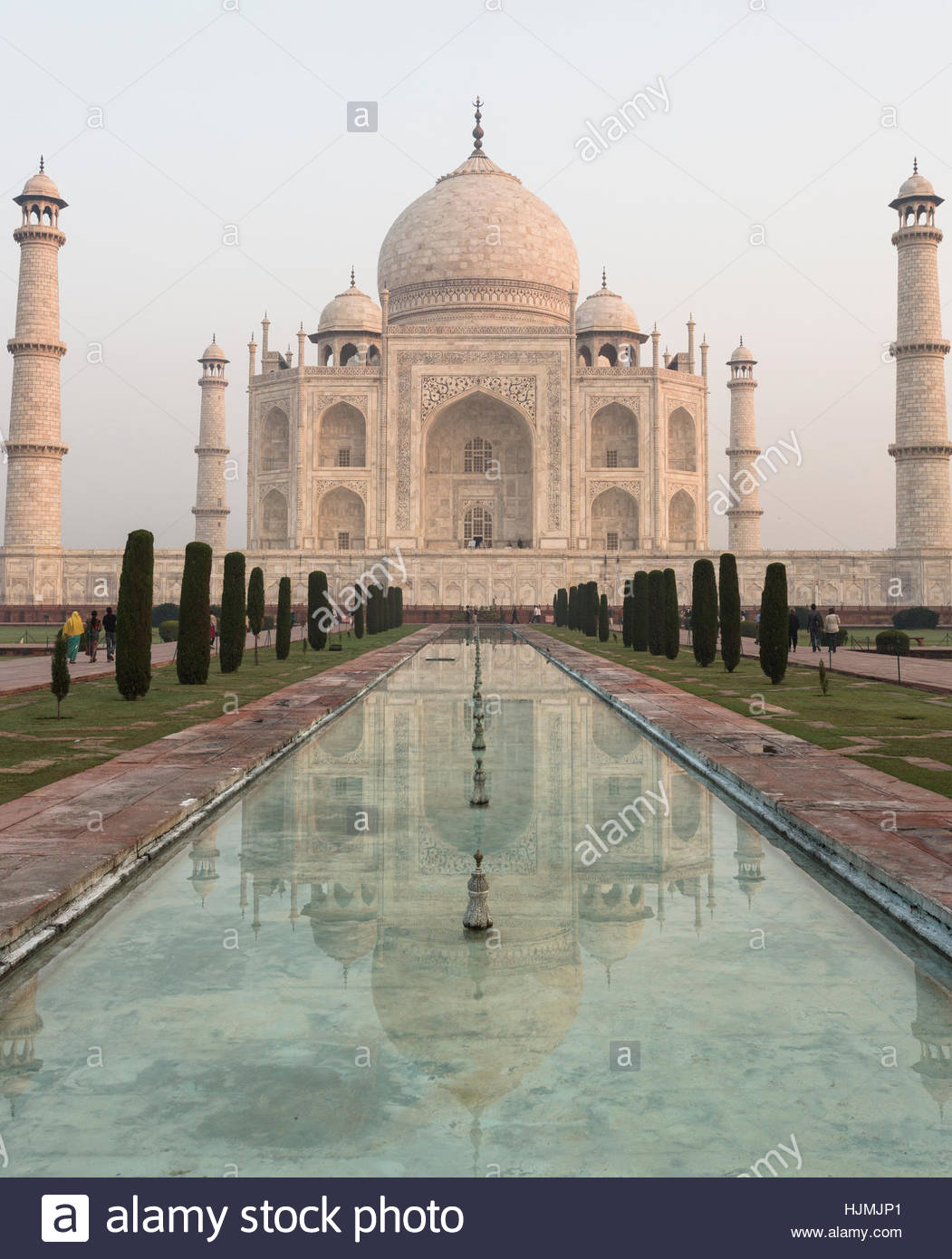The symmetry of the Taj Mahal is perfectly replicated in the adjoining reflecting pool. - Stock Image