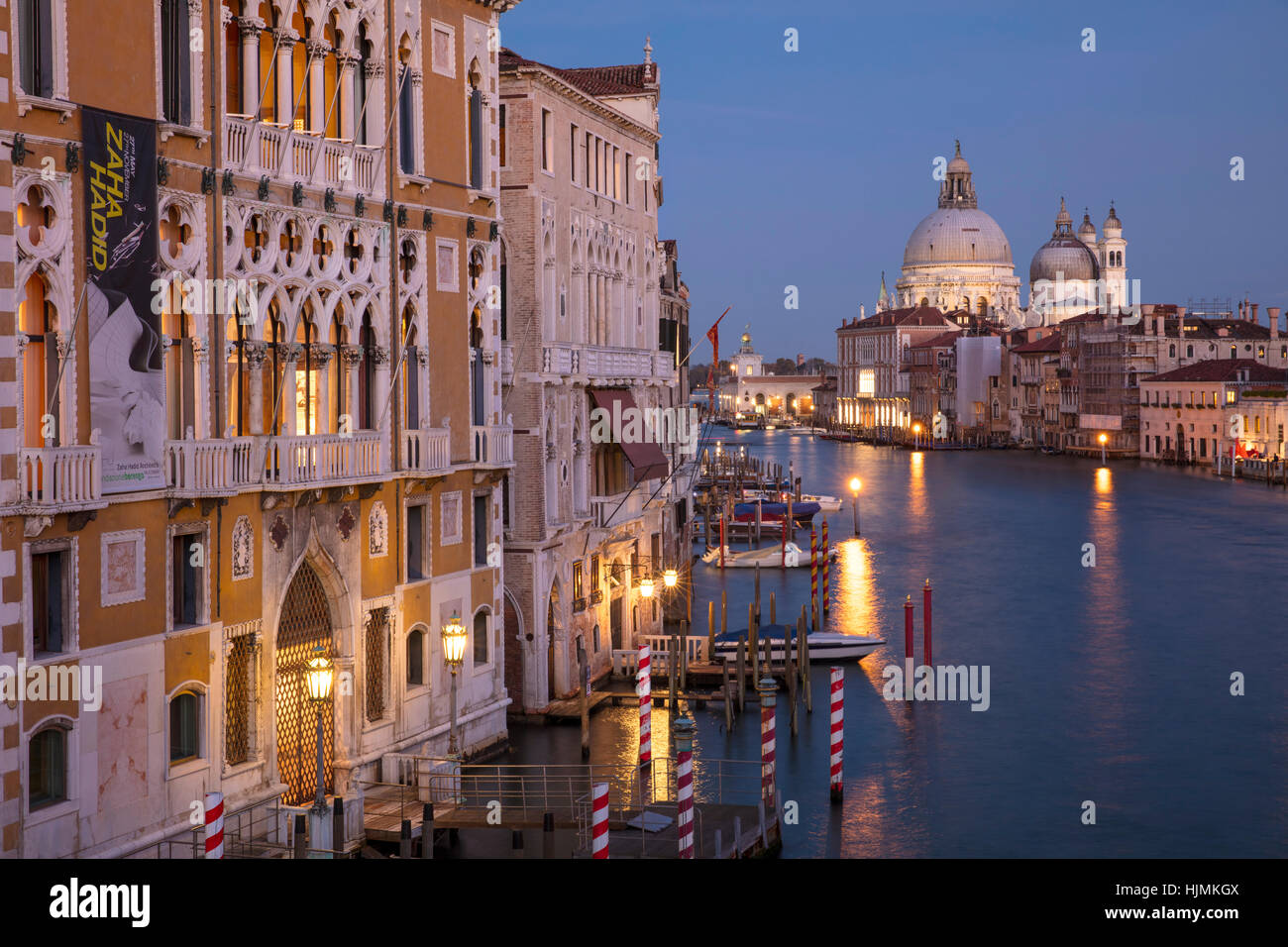 Twilgiht over the buildings along the Grand Canal with Santa Maria della Salute beyond, Venice, Veneto, Italy - Stock Image