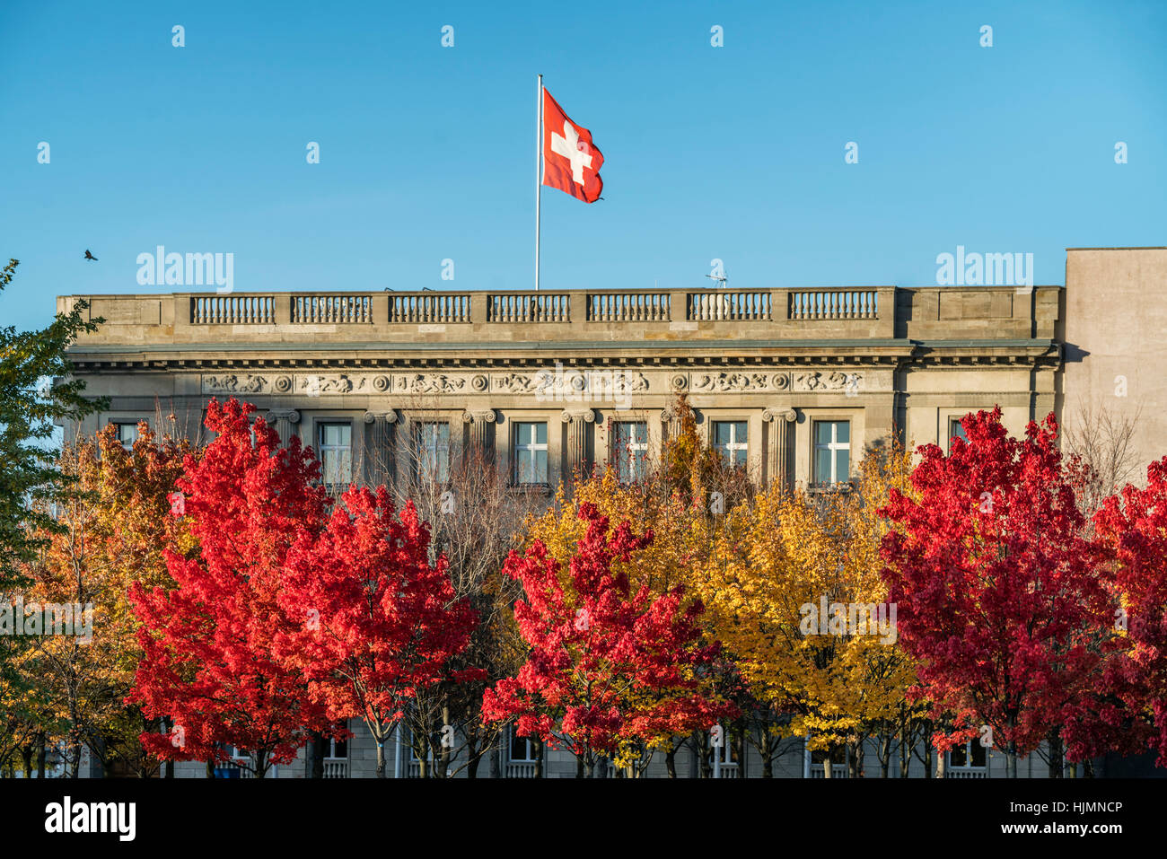 Embassy of Switzerland in Berlin with the Swiss national flag , autumn, Berlin - Stock Image