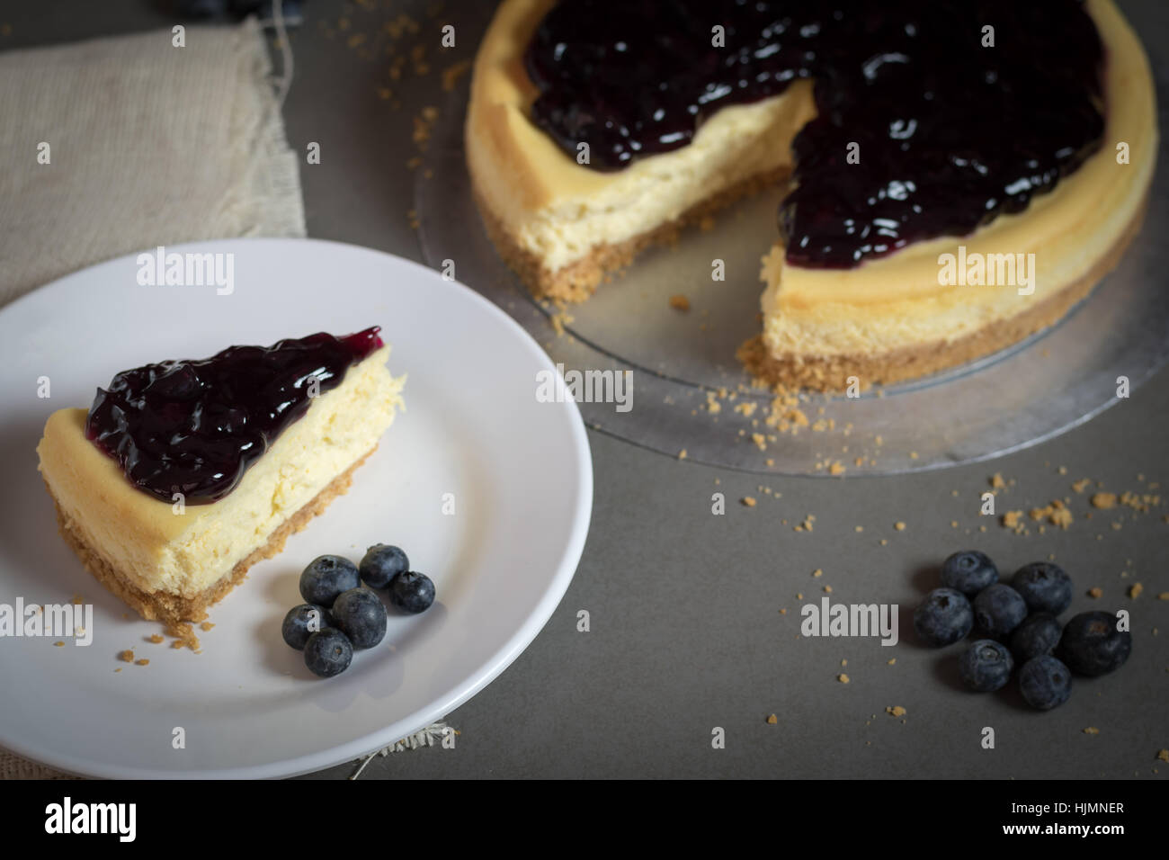 piece of freshness delicious blueberry cheese cake on plate is sweet baked bakery dessert,selective focus. - Stock Image