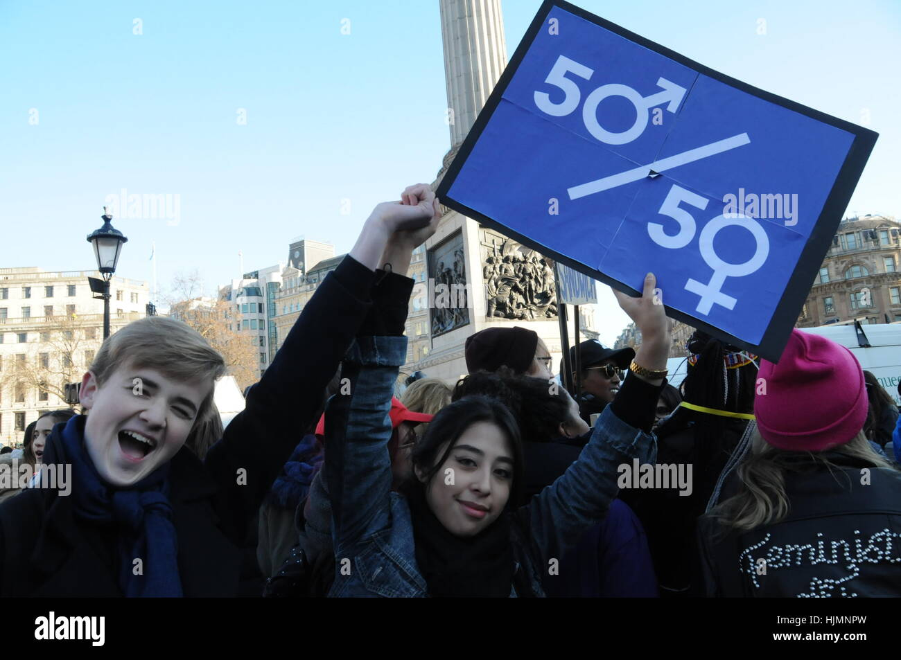 Protesters at the 2017 Women's March against  the US President, Donald Trump, in London's Trafalgar Square. - Stock Image