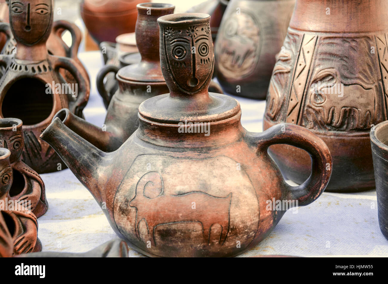 Souvenirs of clay teapots with relief ornament - Stock Image