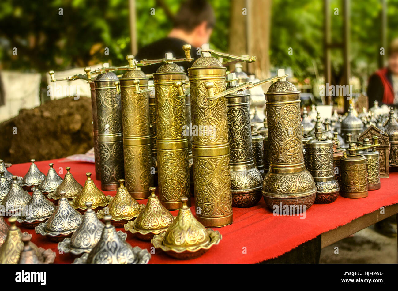 Souvenir coffee mill  with relief ornament of brass - Stock Image