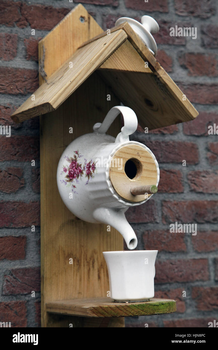 Theepot shaped Birdcage Bird cage without bird - Stock Image