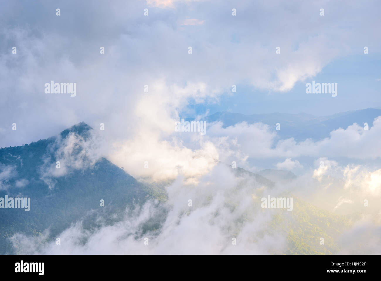 Cloud around mountain with sun shine in the sunset. - Stock Image