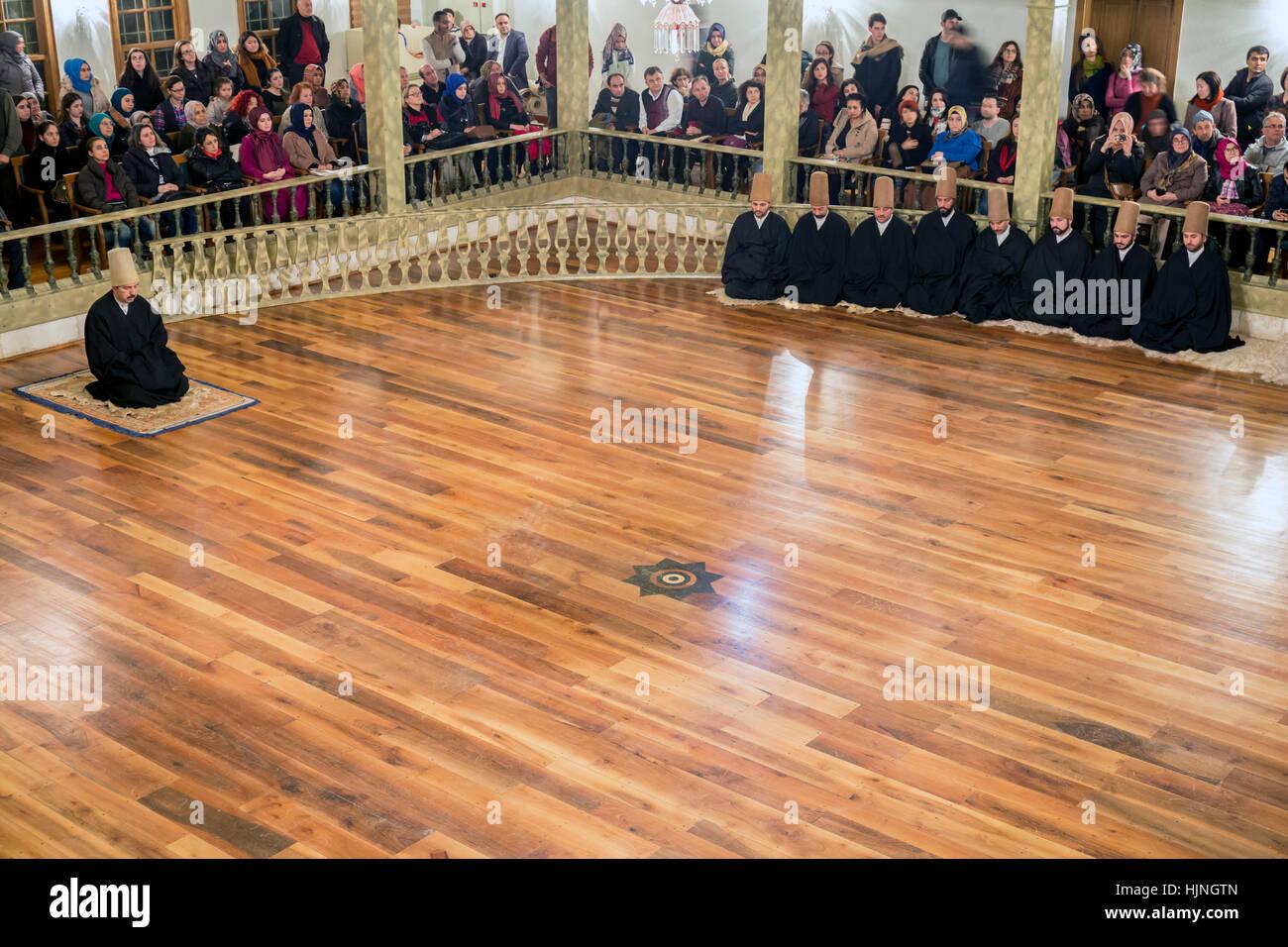 Istanbul, Turkey - January 6, 2016: Tourists visits watch Sema Ceremony in Yenikapi Mevlevihanesi, Istanbul, Turkey - Stock Image