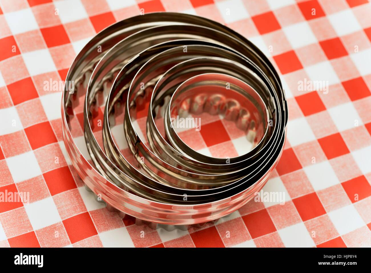 Set of 6 double sided stainless steel cutter - Stock Image