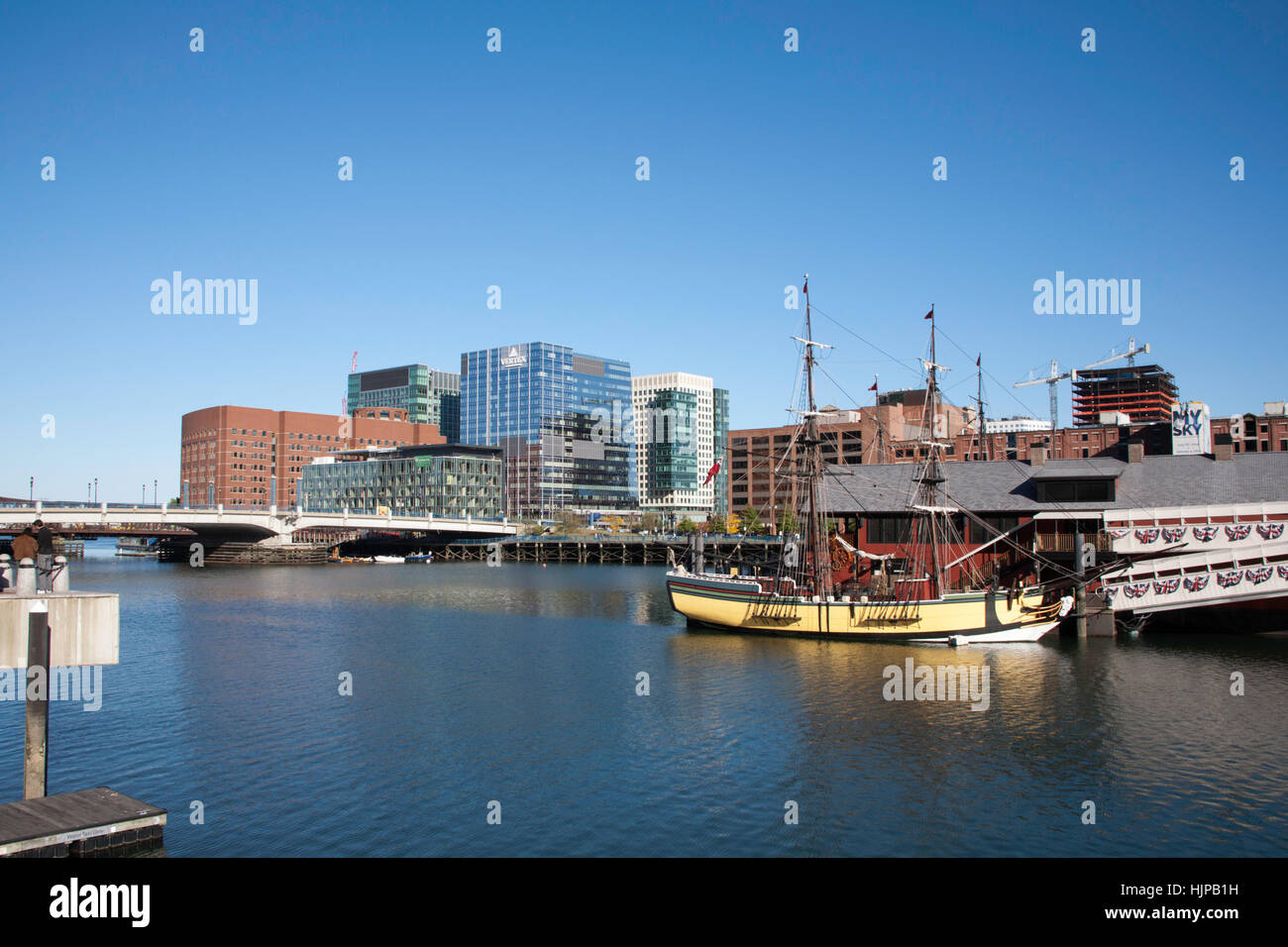 Replica Eighteenth Century sailing ships moored on The Bass River at The Boston Tea Party Museum Boston Massachusetts - Stock Image