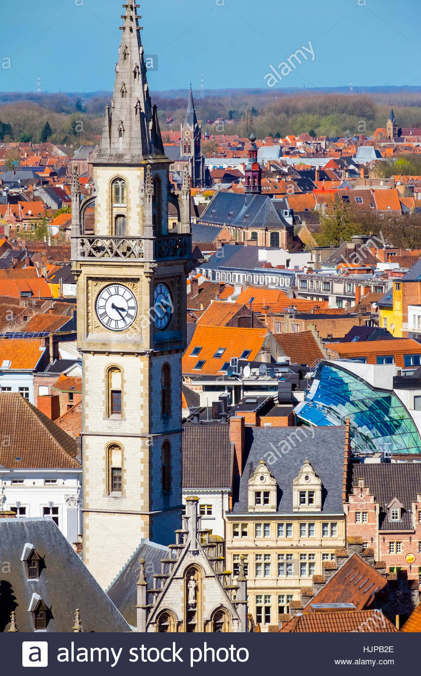 Belgium, Flanders, Ghent (Gent). High-angle view of Old Post Office clocktower and buildings in old town. - Stock Image