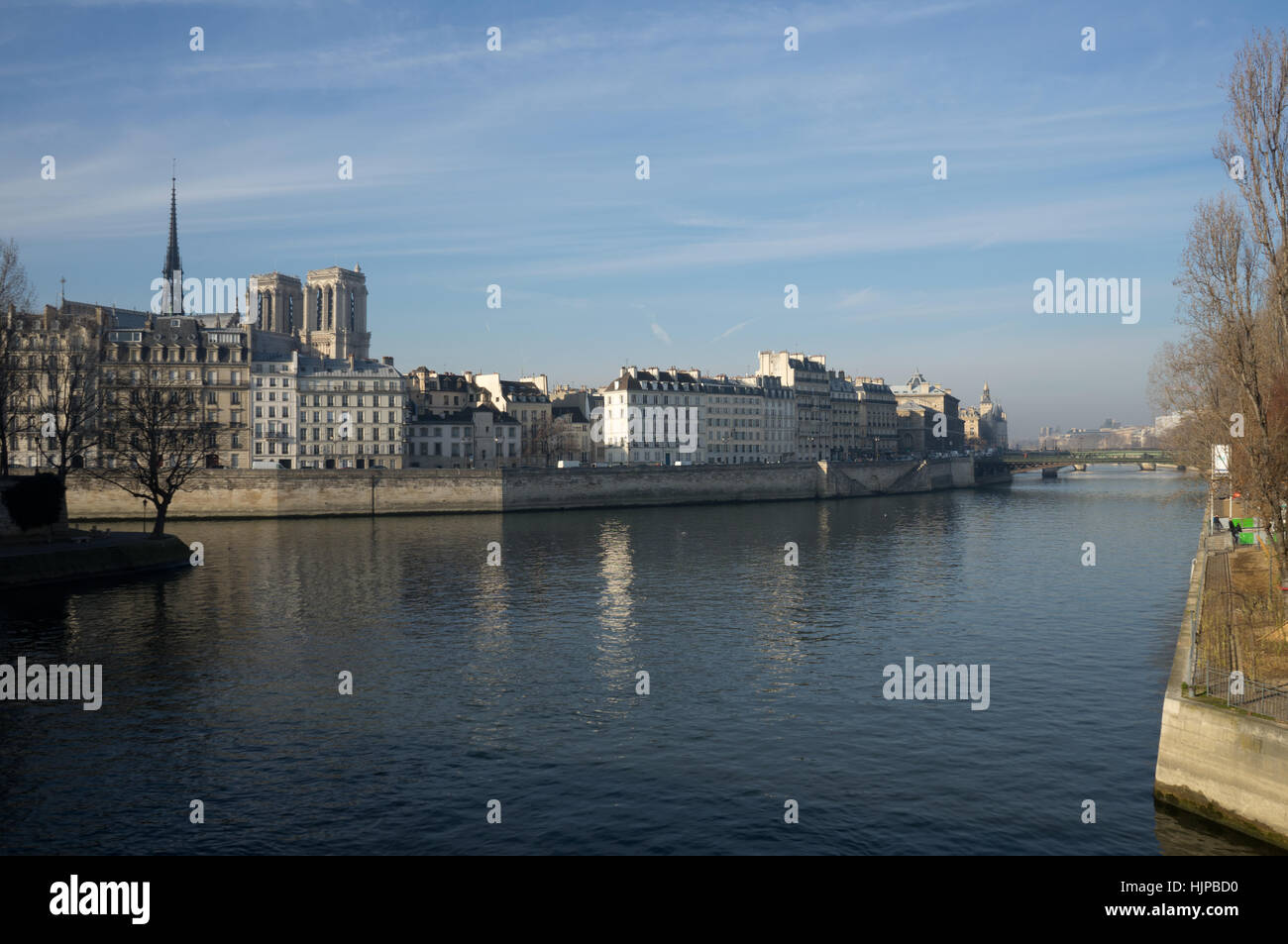 River Seine, Paris looking from Quai de l'Hotel de ville across the bridge to Notre Dame Cathedral. - Stock Image