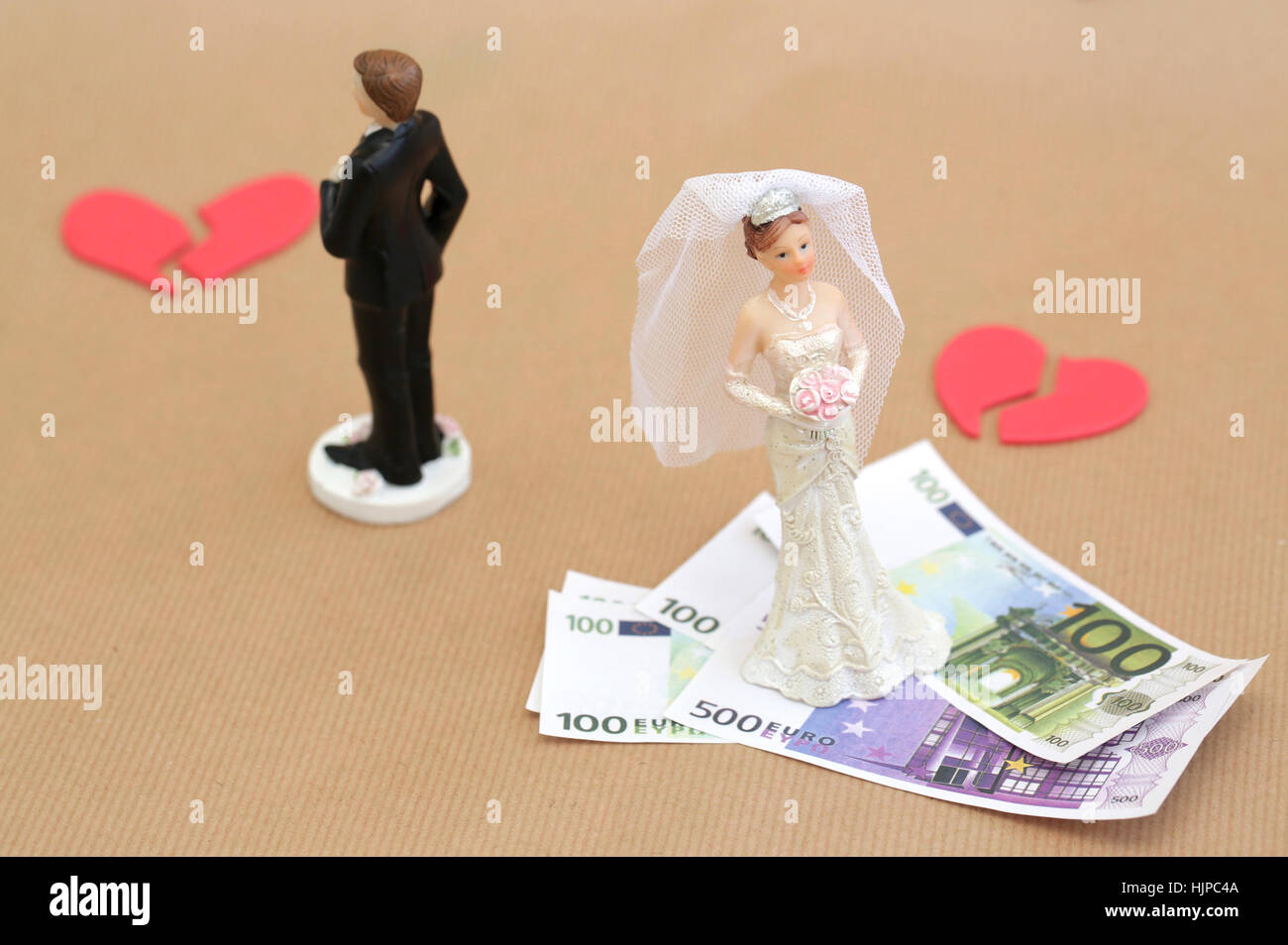 A divorced couple with broken hearts and money - Stock Image