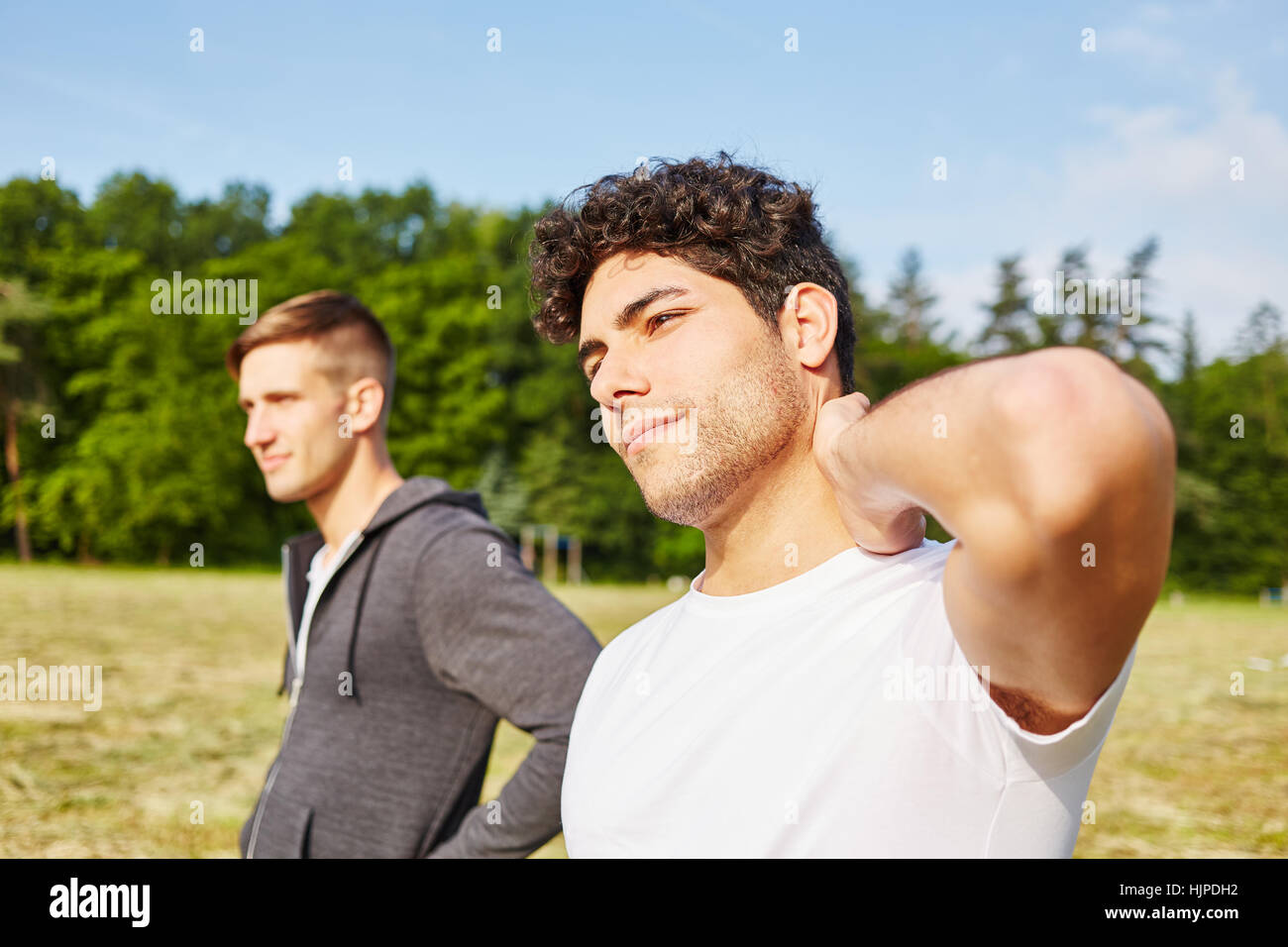 Young men relaxing after doing sport in the summer - Stock Image