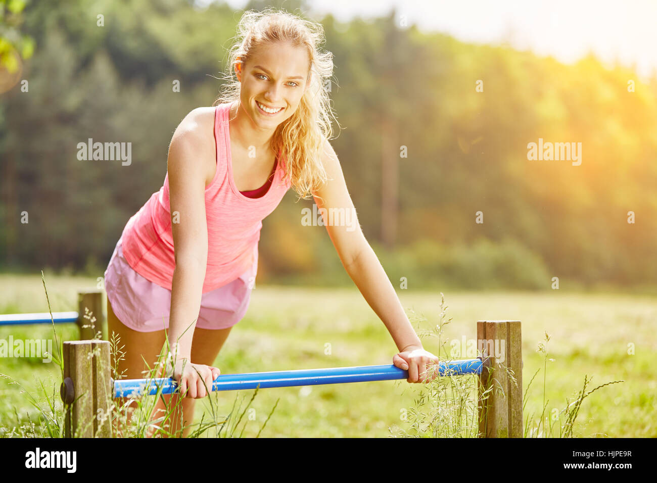 Young woman training in the park to stay fit - Stock Image