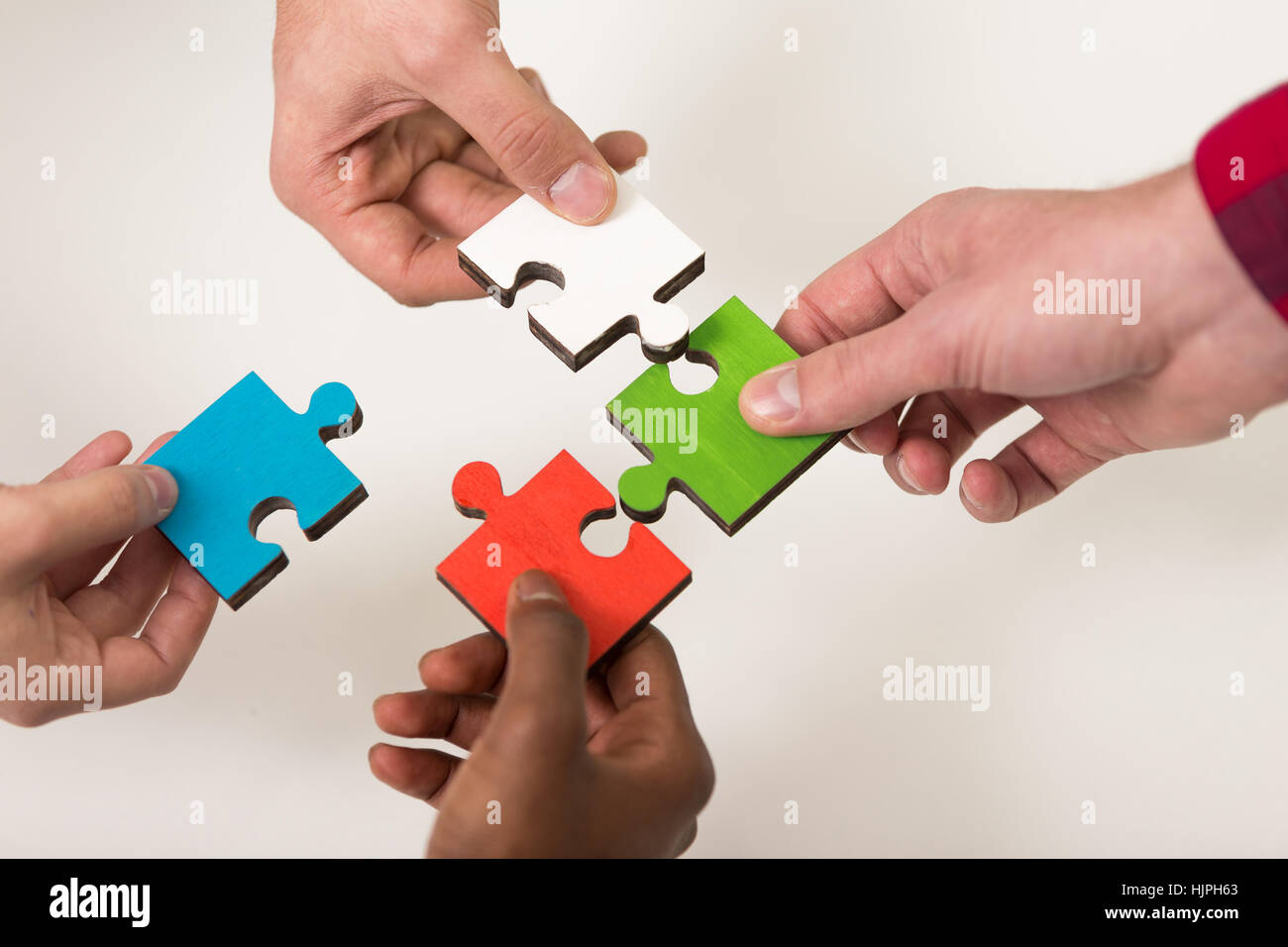 Business People Group Assembling Jigsaw Puzzle And Represent Team