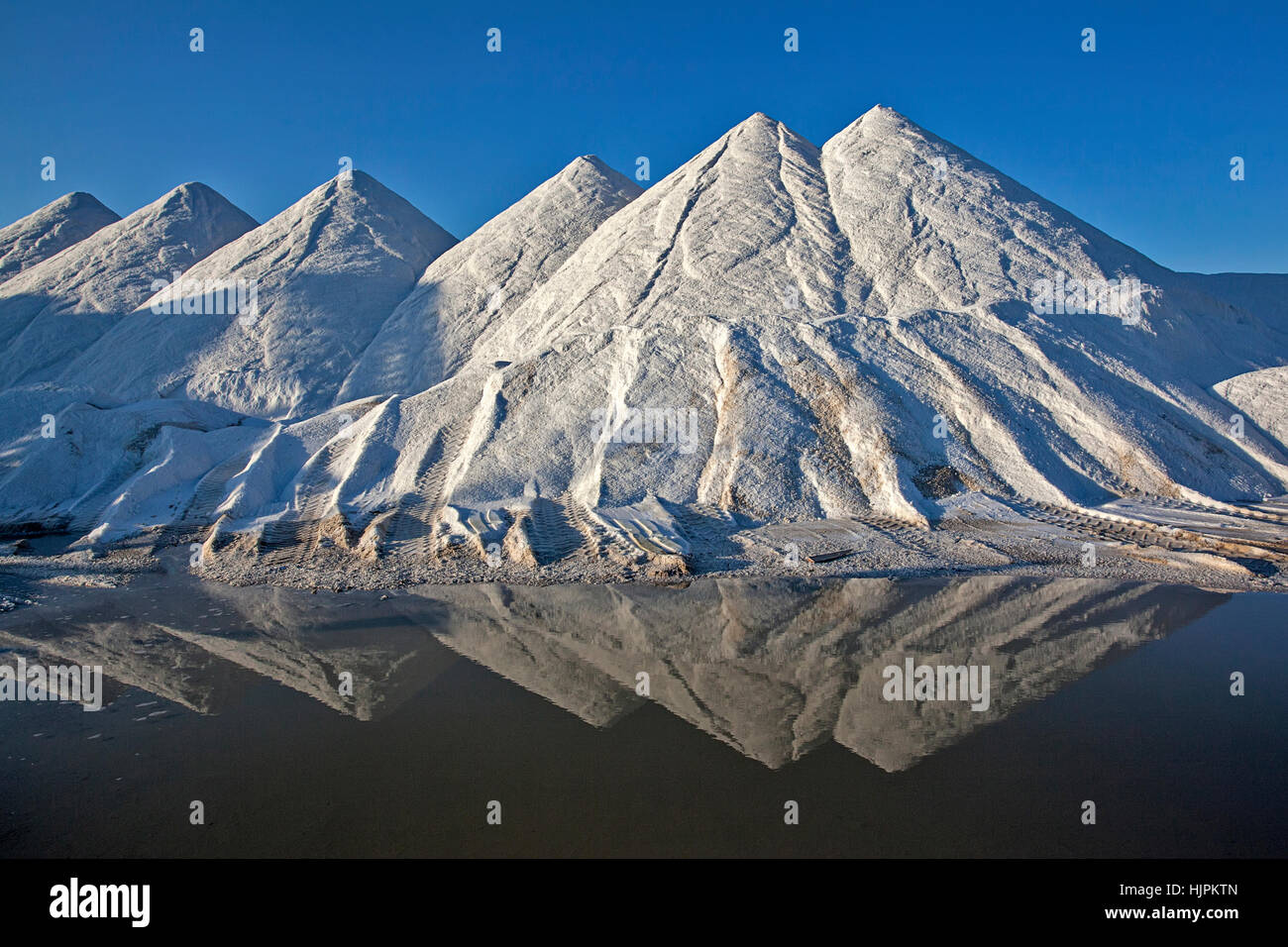 Pyramids of salt on the salt lake in Turkey - Stock Image