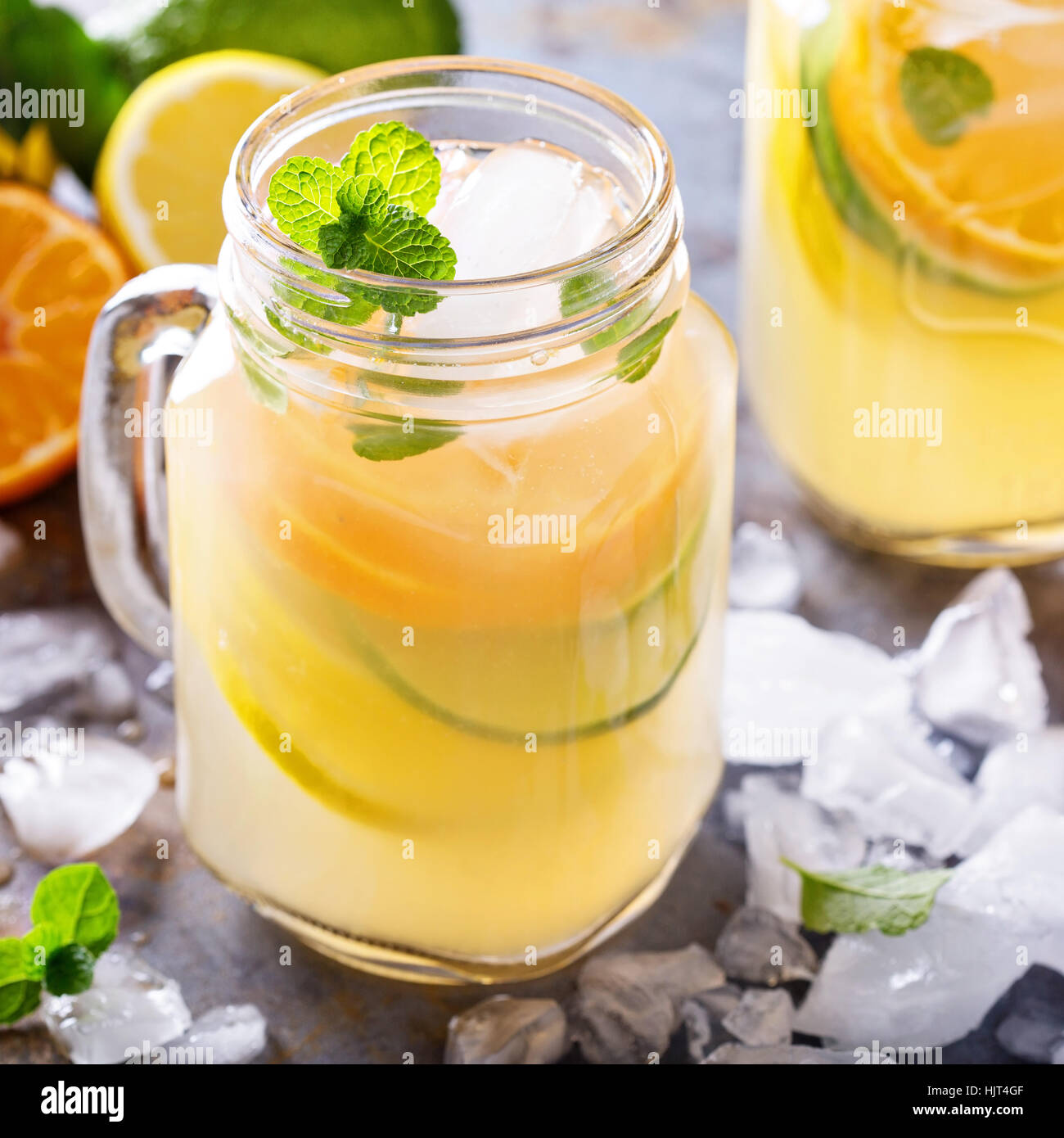 Citrus fruit lemonade in mason jars - Stock Image