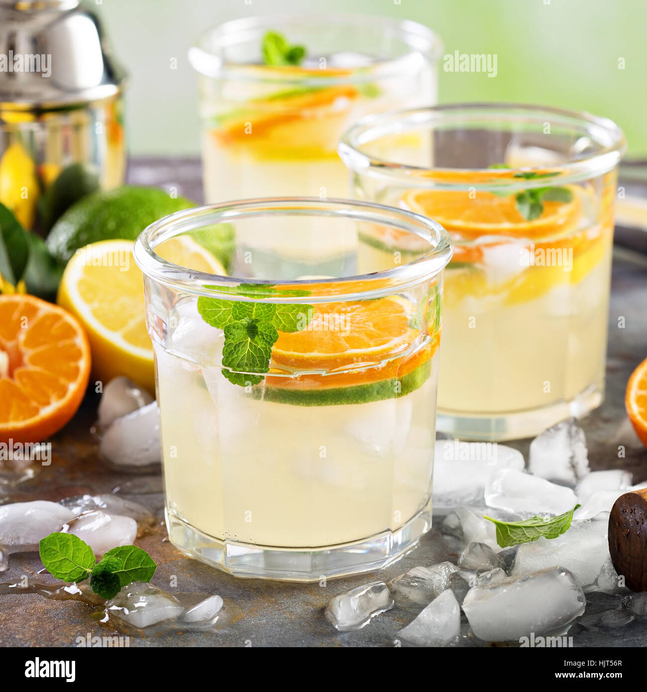 Refreshing summer cocktail with citrus fruits - Stock Image