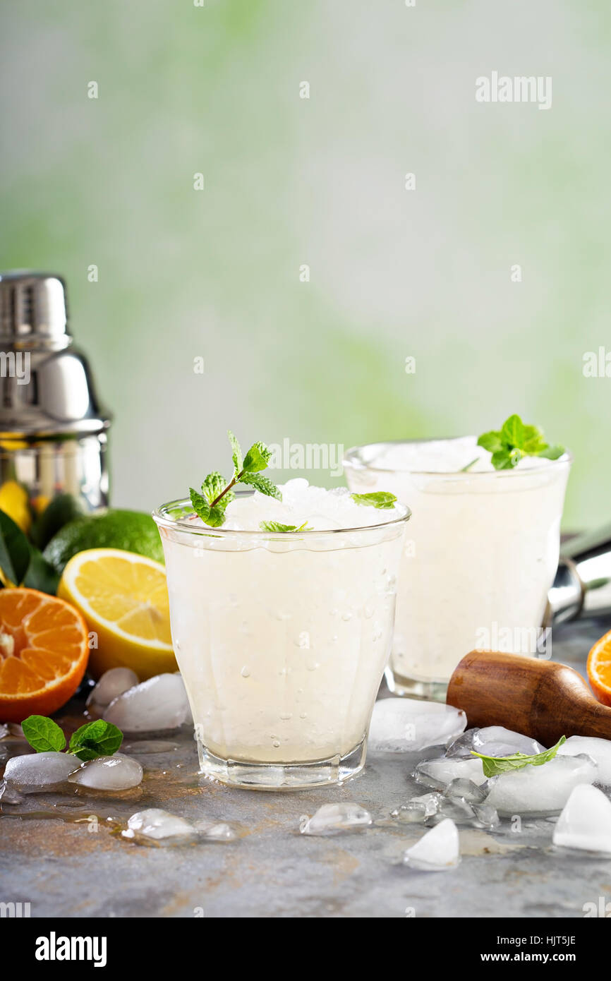 Refreshing summer cocktail with crushed ice - Stock Image