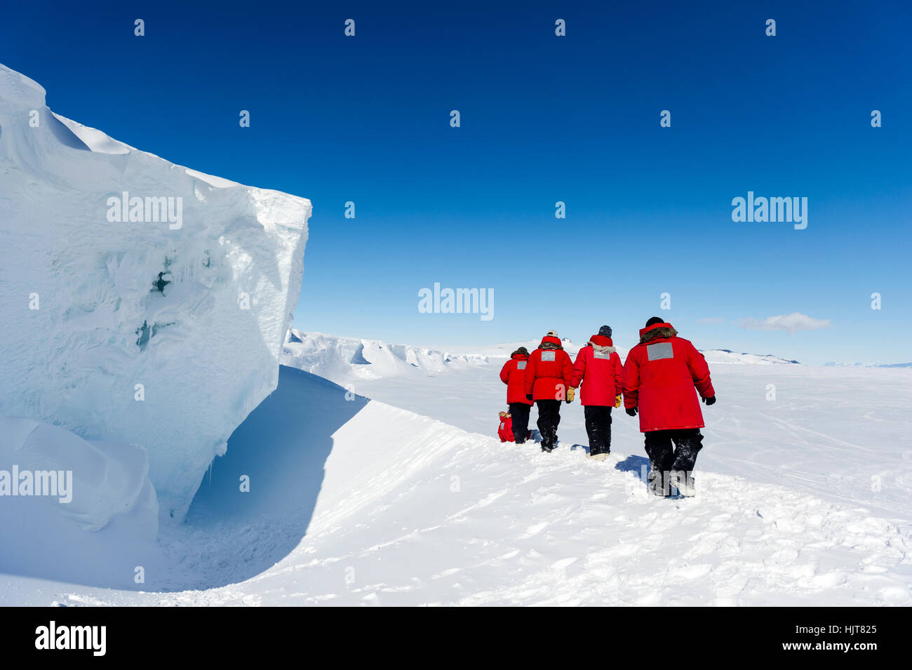 Staff from McMurdo Station exploring an ice cave in the Erebus Glacier Tongue. - Stock Image