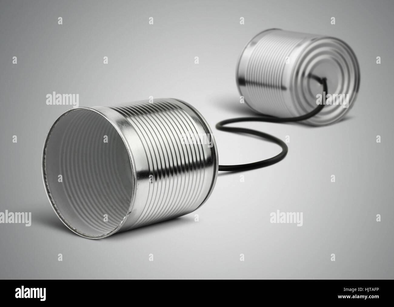 Tin can telephone with cord on grey, telephony concept Stock Photo
