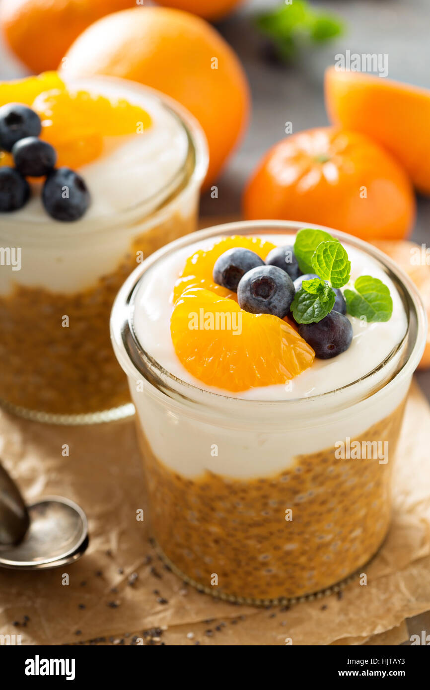 Orange chia pudding with coconut yogurt - Stock Image