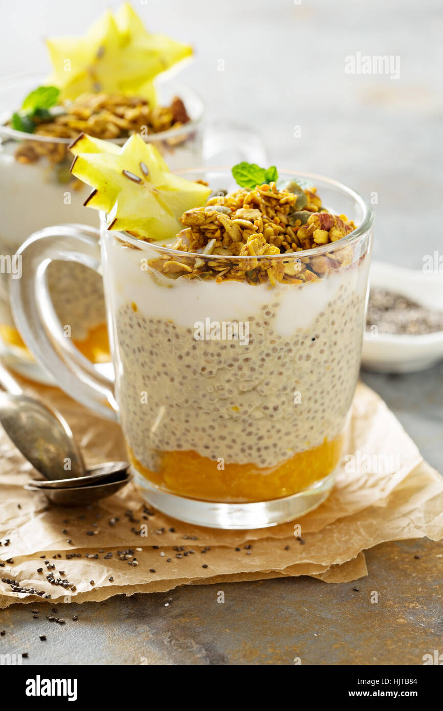 Chia pudding with exotic fruits and granola - Stock Image