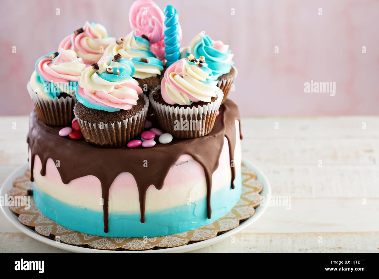 Pink and blue festive cake - Stock Image